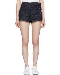 Carven - Indigo Lace-up Ruched Denim Miniskirt - Lyst