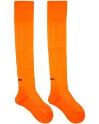 Miu Miu - Orange Over-the-knee Logo Socks - Lyst