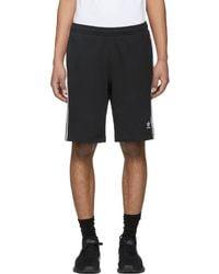 Lyst adidas Originals corriendo Shorts en negro para hombres