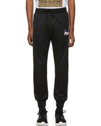 COACH - Black Disney Edition Spooky Eyes Track Trousers - Lyst