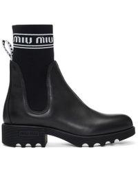 Miu Miu - Black Leather And Sock Boots - Lyst