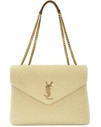 a01bb6ad44d Lyst - Saint Laurent Beige Quilted Large Monogram Chain Bag in Natural