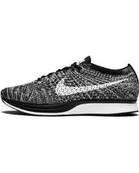573aa72822aa Nike Flyknit Racer in Black for Men - Lyst