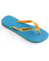 57ec06fcd Havaianas - Turquoise yellow Brasil Logo Flip Flops - Lyst