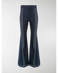 Chloé - Pantaloni svasati con cuciture a contrasto - Lyst
