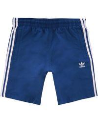 03b17d9322 adidas Originals 3 Stripes Swim Shorts in Blue for Men - Lyst