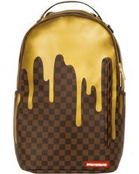 Sprayground - Gold Chequered Drips Backpack - Lyst