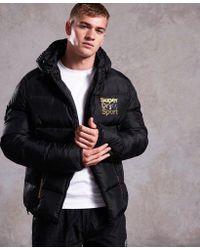 Superdry - Gym Tech Gold Puffer Jacket - Lyst