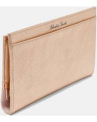 0ddd45ff35f81c Ted Baker - Bow Detail Leather Travel Wallet - Lyst
