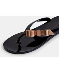 a24b270f70b4 Lyst - Ted Baker Bow Detail Jelly Sandal in Black