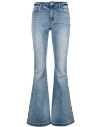 MICHAEL Michael Kors - Studded Flare Jeans - Lyst