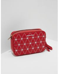 54cb9f19b6 Lyst - Michael Kors Ginny Bright Red Tumbled Leather Camera Bag in Red