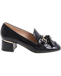 Tod's - Black Pumps With Tassels And Silver Logo - Lyst