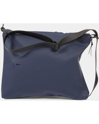 Rains - Sling Bag Navy - Lyst