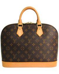 d8bbf74b7f22 Lyst - Louis Vuitton Monogram Canvas Tikal Gm Bag in Brown