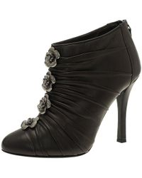 Chanel - Dark Pleated Leather Camellia Ankle Boots - Lyst