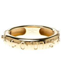 Louis Vuitton Bangle Family Debossed Signature Gold Tone Bracelet - Metallic