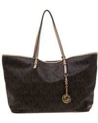fe47301bbadd MICHAEL Michael Kors - Michael Kors Brown Signature Coated Canvas Jet Set  Tote - Lyst