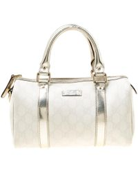 0d4d10950b8 Gucci - Off White gold GG Supreme Canvas Small Joy Boston Bag - Lyst
