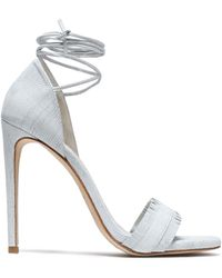 Stuart Weitzman - Nudewrap Fringe-trimmed Lizard-effect Leather Sandals - Lyst