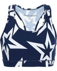 Perfect Moment - Woman Printed Stretch Sports Bra Navy - Lyst