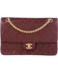fb6c461f1d76 Chanel Vintage Lambskin Flap Bag Black in Metallic | Lyst