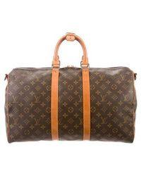 579e74619bdb Lyst - Louis Vuitton Keepall Bandouliere 60 Monogram - Vintage in Brown