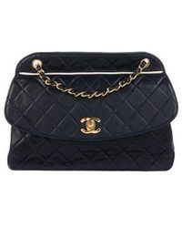 cff63dd74ad0 Lyst - Chanel Vintage Quilted Lambskin Flap Bag Black in Metallic