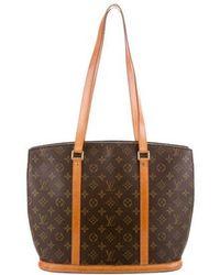 07e0a66369e 2010 Monogram Aviator Bag Grey.  925. The RealReal · Louis Vuitton -  Monogram Sac Shopping Bag Brown - Lyst