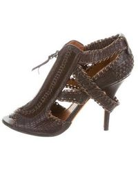 a82f5abb1db Lyst - Givenchy Leather Peep-toe Pumps in Black