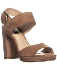 d526616deeb9 DKNY Josie Leather And Rubber Wedge Sandals in White - Lyst