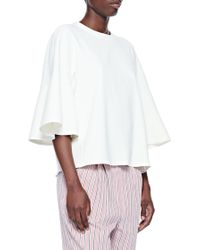 5aa62367a07 Tibi Drape Twill Off-shoulder Top in White - Lyst