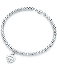 f80f6ed34 Tiffany & Co. Peace Tag In Sterling Silver On An Onyx Bead Bracelet ...