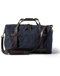 Filson - Duffle Carry-on In Navy - Lyst
