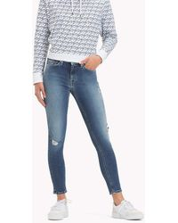 ecf9aeac Tommy Hilfiger - Nora Mid Rise Distressed Skinny Jeans - Lyst