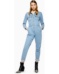 137968b6956 Lyst - TOPSHOP Moto Zip Front Denim Jumpsuit in Blue