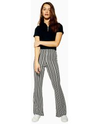 TOPSHOP - Petite Stripe Flared Trousers - Lyst