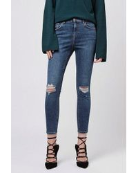 TOPSHOP - Petite Ripped Jamie Jeans - Lyst