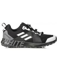b66b7a5f53b0 Lyst - Men s White Mountaineering Trainers Online Sale
