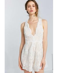 Love Triangle - Arabesque Plunging Lace Romper - Lyst