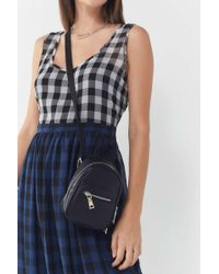 Lyst - Urban Outfitters Deena Ozzy Tassel Square Backpack in Black 18eb15391c