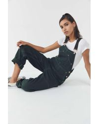 a660828cee5 BDG Riveter Denim Coverall Jumpsuit in Blue - Lyst