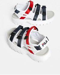 35d9e8e923b5 Fila White Logo Strap Disruptor Sandal in White - Lyst