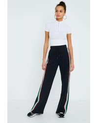 Urban Outfitters - Uo Black Rainbow Taped Puddle Joggers - Lyst