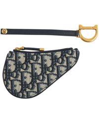 8d600fa309b4 À découvrir   Porte-monnaie et portefeuilles Dior femme à partir de 55 €