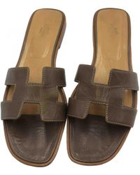 22fcaff54e22 Hermès - Pre-owned Oran Brown Leather Sandals - Lyst
