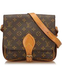 8bf4a677f883 Lyst - Louis Vuitton Cloth Handbag in Brown - Save 18%