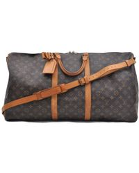 7d45f8b0b759 Louis Vuitton - Pre-owned Vintage Keepall Brown Cloth Travel Bags - Lyst