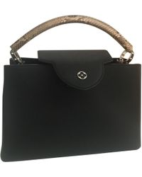 Lyst - Louis Vuitton Taurillon Leather Capucines Mm Bag in Black 5d2f34ebd075c