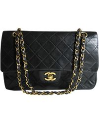 Chanel - Pre-owned Vintage Timeless/classique Black Leather Handbags - Lyst